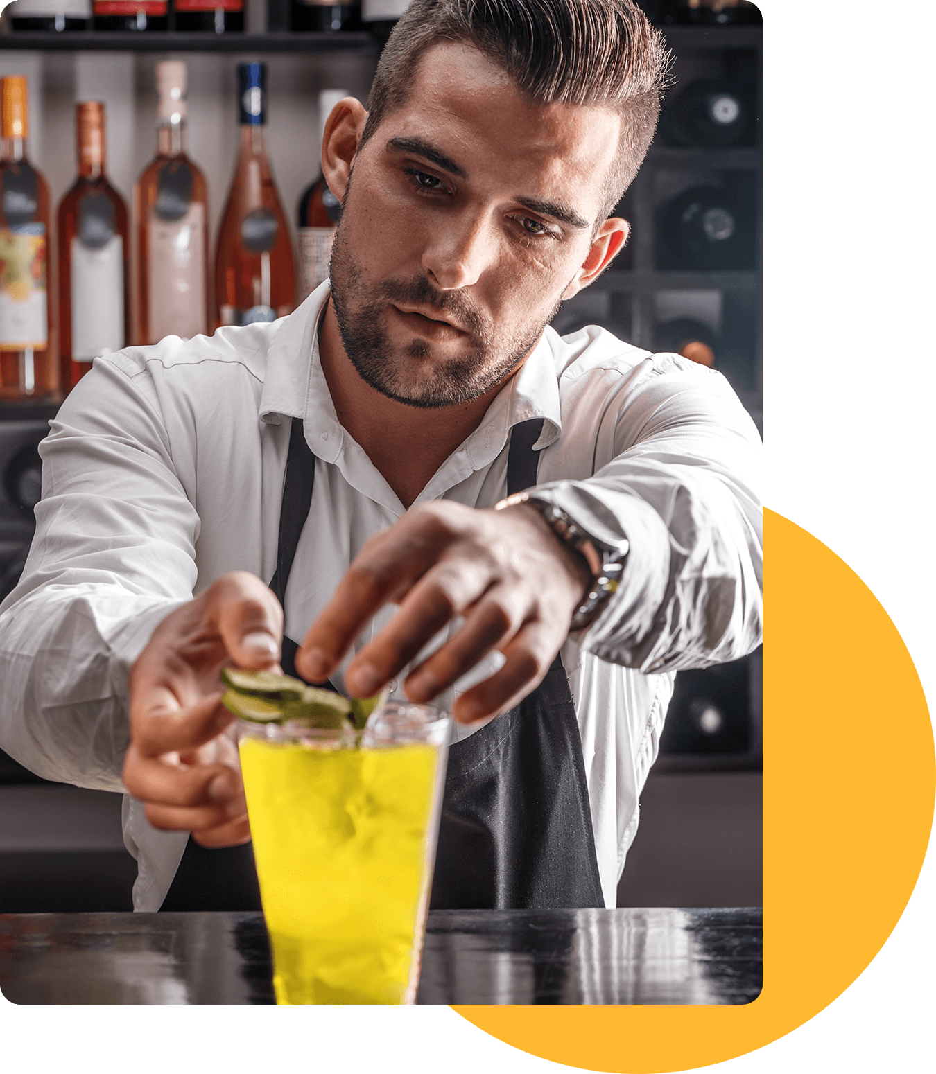Bartender makes the official Gin Hass Mango cocktail